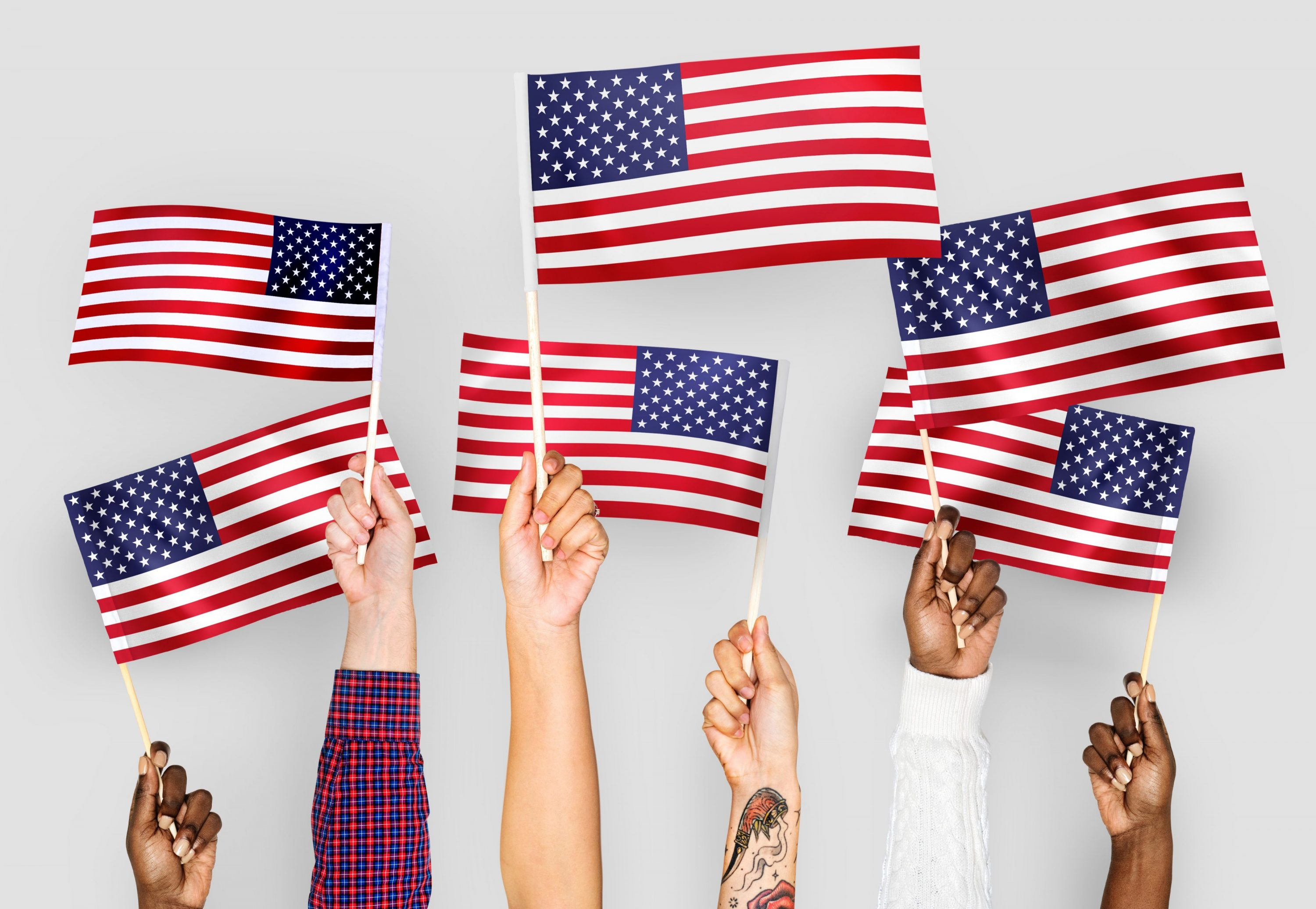 Team of people waving flags of USA